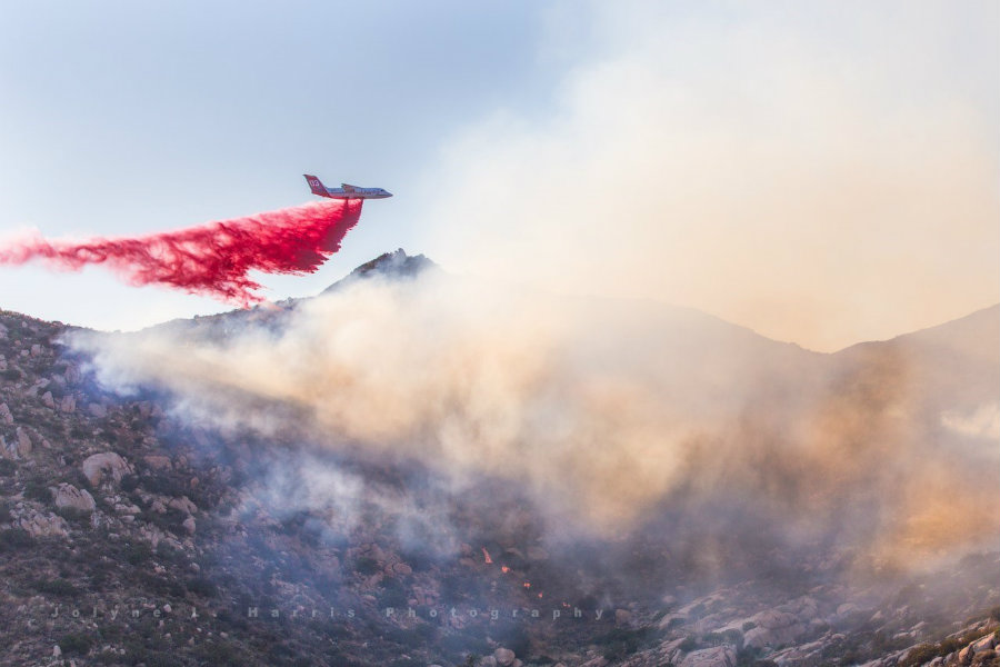 A shot of a plane helping firefighters to decrease the fire's potency and reach along San Gabriel Mountains. Image Credit: California Dolphin