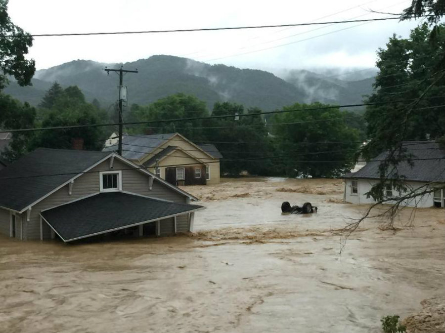In this photo released by the The Weather Channel, the water levels appear to reach not so far from the houses' roofs. Image Credit: WDBJ7