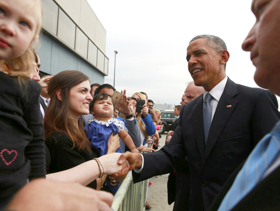 President Barack Obama salutes the crowds of supporters on his visit to Seattle earlier this week. Image Credit: Seattle Times