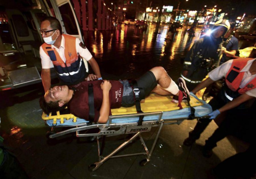 A man is taken to an ambulance following the explosion of a train in Taipei City. The unexpected blast went off on Thursday afternoon, leaving 21 people injured. Image Credit: Yahoo