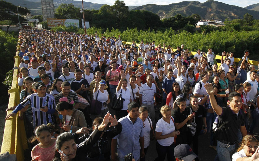 Venezuelans express their happiness as they walk in by the thousands into Colombia. Image Credit: Aljazeera