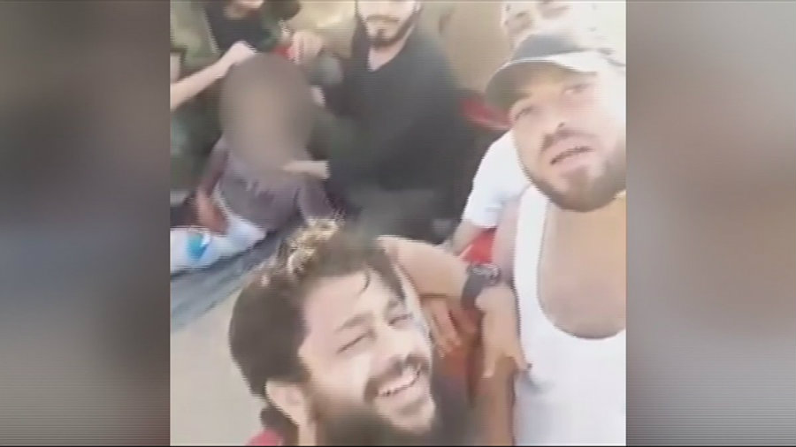 The Nour al-Din al-Zinki Movement has been accused of beheading a 12-year-old Palestinian boy who was believed to be a child soldier fighting in support of the government. The group recorded the scene in a video posted online on Tuesday. Photo credit: Scoopnest